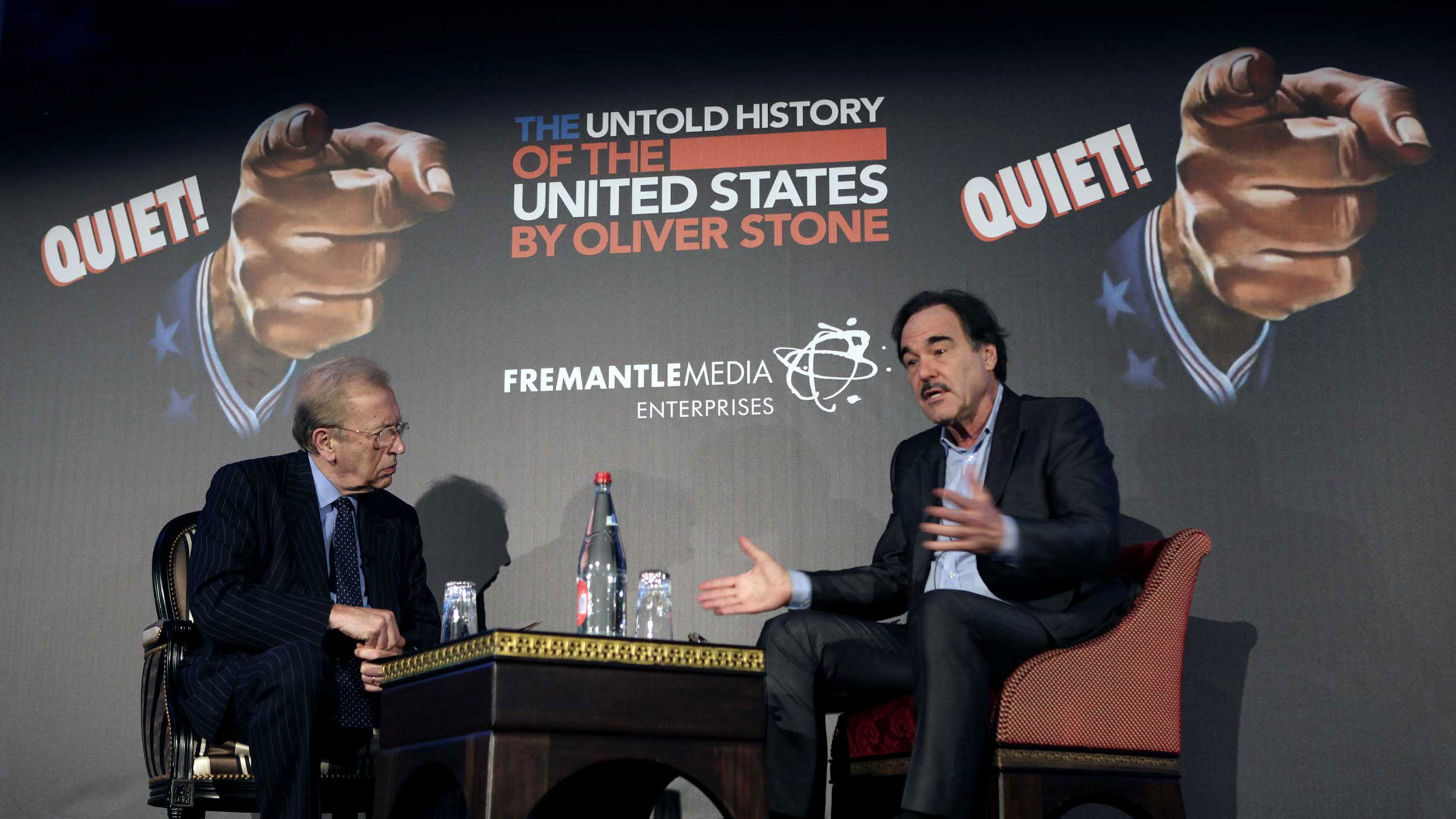 Oliver Stone talks to Sir David Frost at MIPCOM in Cannes